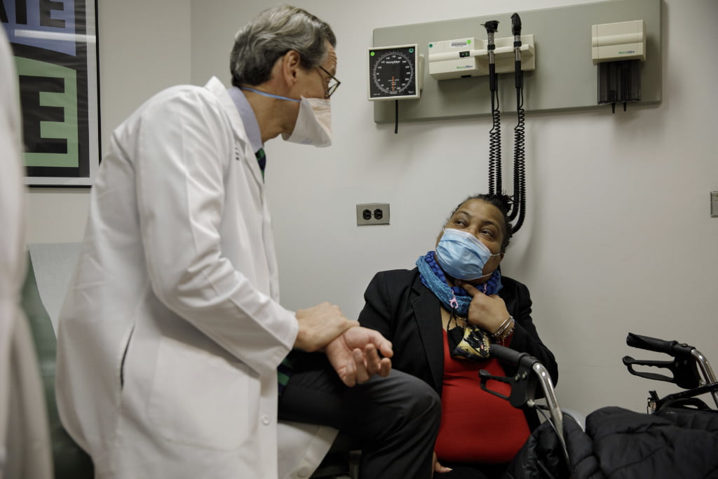 Trachea transplant recipient Sonia Sein talks with the lead surgeon of her procedure, Dr. Eric Genden, left, during a checkup visit at Mt. Sinai hospital in New York.