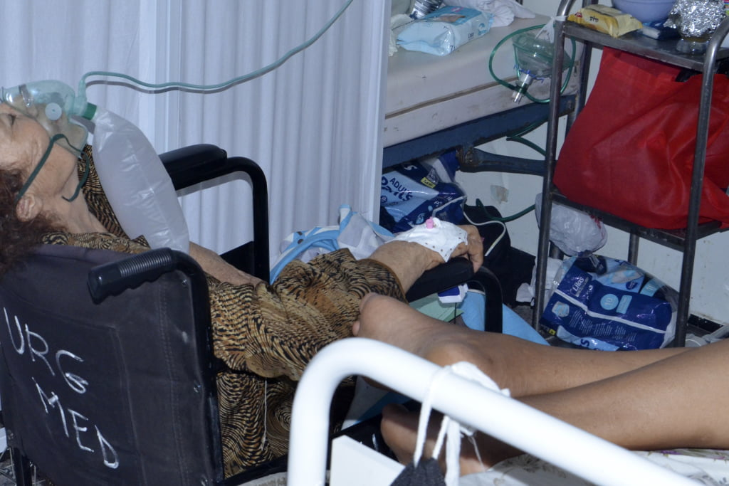 A COVID-19 patient breathes with the help of an oxygen mask at the Iben El Jazzar hospital in Kairouan, Tunisia.